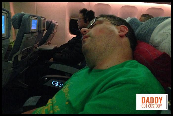 Sleeping on the Plane to China by http://DaddyGotCustody.com